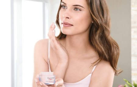 Female with Eucerin Even Brighter cream