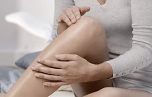 Woman uses care on legs and knees