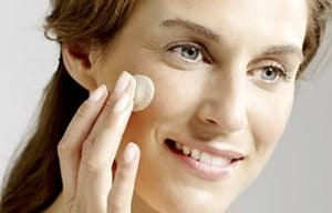Woman using day cream