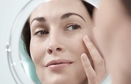 Woman applies Eucerin Volume-Filler Eye Cream