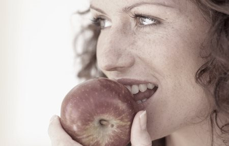 Woman eating an apple
