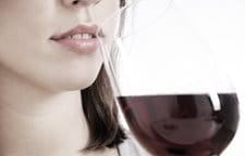Woman drinking a glass of red wine.